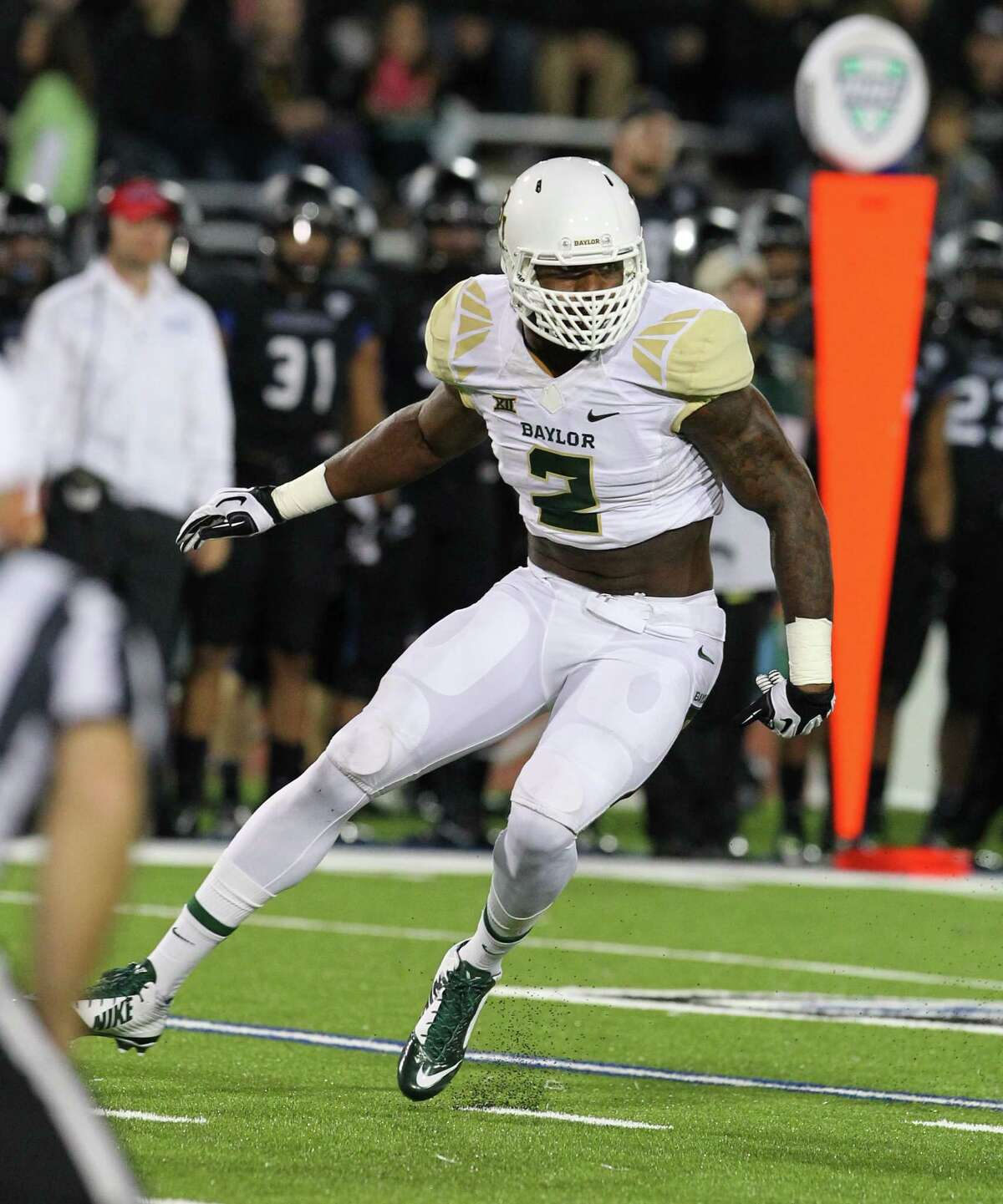 Baylor defensive end Shawn Oakman (2) breaks off the line against Buffalo during the first half of an NCAA college football game on Friday, Sept. 12, 2014, in Amherst, N.Y.