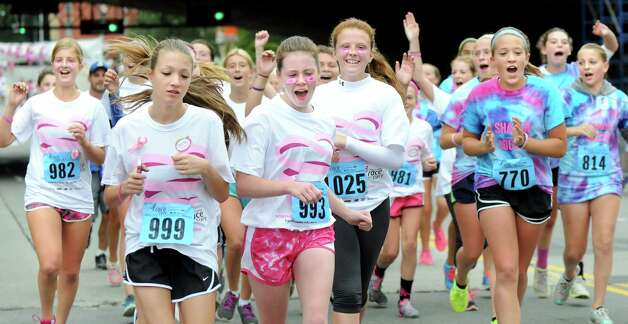 The Shaker girls soccer team crosses the finish line as a group during the 20th annual Komen Northeastern New York Race for the Cure  on Saturday, Sept. 13, 2014, in Albany, N.Y. (Cindy Schultz / Times Union) Photo: Cindy Schultz / 00028603A