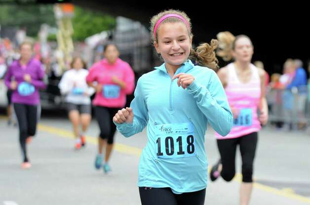 Shayna Lenney, 13, of East Greenbush, center, crosses the finish line during the 20th annual Komen Northeastern New York Race for the Cure  on Saturday, Sept. 13, 2014, in Albany, N.Y. (Cindy Schultz / Times Union) Photo: Cindy Schultz / 00028603A