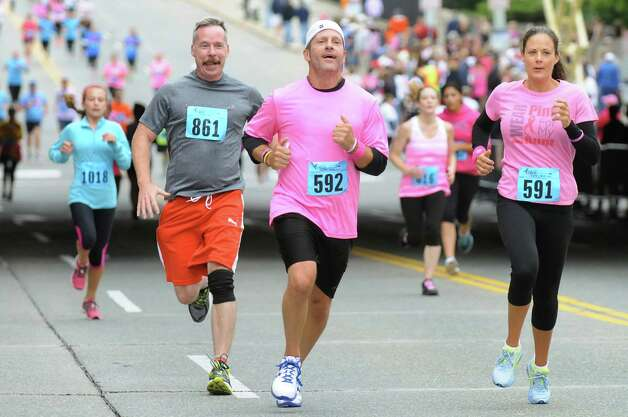Friends Bill Bernosky, left, John Docherty, center, and Tracey Amash, all of Albany, try to outrace each other at the finish line during the 20th annual Komen Northeastern New York Race for the Cure  on Saturday, Sept. 13, 2014, in Albany, N.Y. (Cindy Schultz / Times Union) Photo: Cindy Schultz / 00028603A