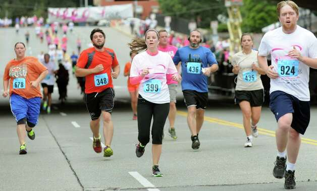 Runners approach the finish line during the 20th annual Komen Northeastern New York Race for the Cure  on Saturday, Sept. 13, 2014, in Albany, N.Y. (Cindy Schultz / Times Union) Photo: Cindy Schultz / 00028603A