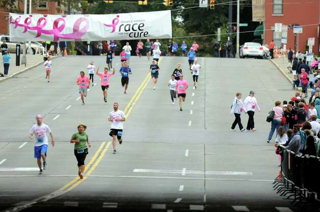 Participants run down Madison Avenue in the final leg of  the 20th annual Komen Northeastern New York Race for the Cure  on Saturday, Sept. 13, 2014, in Albany, N.Y. (Cindy Schultz / Times Union) Photo: Cindy Schultz / 00028603A