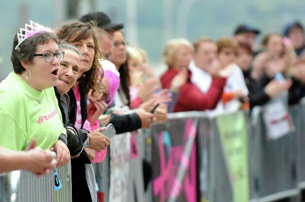 Spectators cheer for runners during the 20th annual Komen Northeastern New York Race for the Cure  on Saturday, Sept. 13, 2014, in Albany, N.Y. (Cindy Schultz / Times Union) Photo: Cindy Schultz / 00028603A
