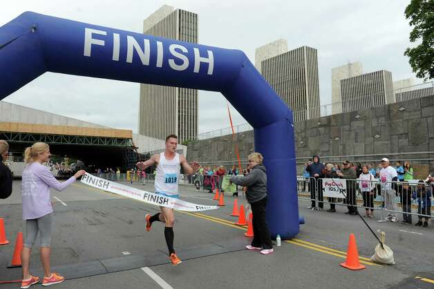 Aaron Lozier of Albany is the first to cross the finish line during the 20th annual Komen Northeastern New York Race for the Cure  on Saturday, Sept. 13, 2014, in Albany, N.Y. (Cindy Schultz / Times Union) Photo: Cindy Schultz / 00028603A