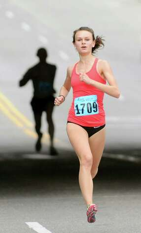 Courtney Breiner, 17, of Troy comes in second overall during the 20th annual Komen Northeastern New York Race for the Cure  on Saturday, Sept. 13, 2014, in Albany, N.Y. (Cindy Schultz / Times Union) Photo: Cindy Schultz / 00028603A