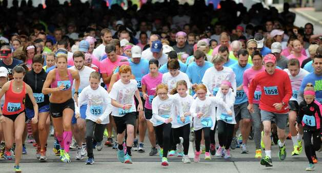 Runners of all ages start the 20th annual Komen Northeastern New York Race for the Cure  on Saturday, Sept. 13, 2014, in Albany, N.Y. (Cindy Schultz / Times Union) Photo: Cindy Schultz / 00028603A