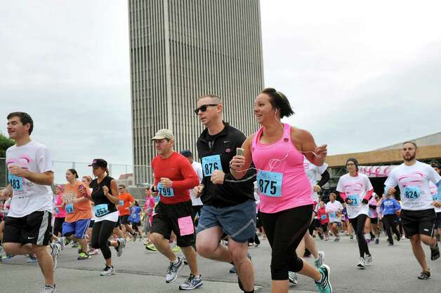 Runners start climbing Madison Avenue during the 20th annual Komen Northeastern New York Race for the Cure  on Saturday, Sept. 13, 2014, in Albany, N.Y. (Cindy Schultz / Times Union) Photo: Cindy Schultz / 00028603A