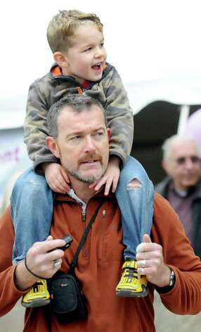 Ronan Wood, 3, of Glenville, top, gets a good view from the shoulders of his father, Bernie Wood, during the 20th annual Komen Northeastern New York Race for the Cure  on Saturday, Sept. 13, 2014, in Albany, N.Y. (Cindy Schultz / Times Union) Photo: Cindy Schultz / 00028603A