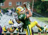 Trinity Catholic's Thomas Costigan makes a catch and comes down in the endzone for a touchdown during Saturday's football game against Sheehan at Trinity Catholic High School in Stamford, Conn., on September 13, 2014.
