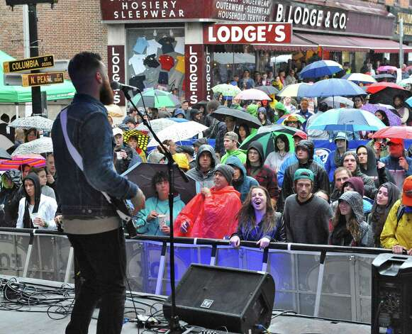 A wet but enthusiastic crowd cheers on the Northern Faces  as they perform at the 5th annual Pearlpalooza Saturday Sept. 13, 2014, in Albany, NY.  (John Carl D'Annibale / Times Union) Photo: John Carl D'Annibale / 00028420A
