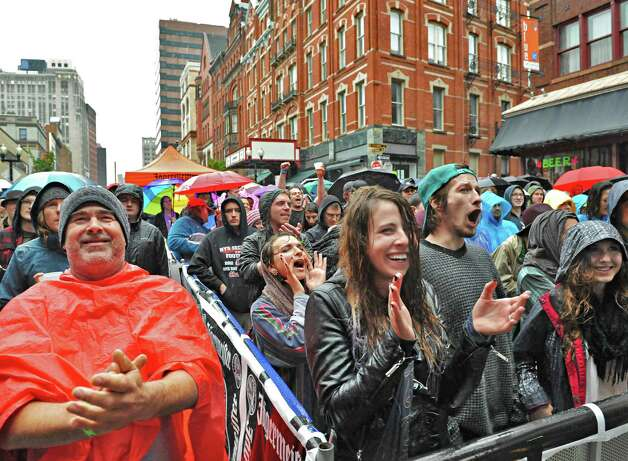 A wet but enthusiastic crowd cheers performers during the 5th annual Pearlpalooza Saturday Sept. 13, 2014, in Albany, NY.  (John Carl D'Annibale / Times Union) Photo: John Carl D'Annibale / 00028420A