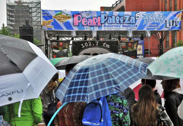 An umbrella-covered crowd listens to music during the 5th annual Pearlpalooza Saturday Sept. 13, 2014, in Albany, NY.  (John Carl D'Annibale / Times Union) Photo: John Carl D'Annibale / 00028420A