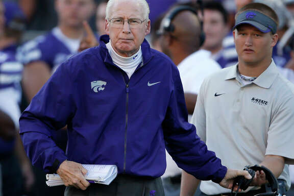FILE - In this Oct. 12, 2013, file photo, Kansas State coach Bill Snyder takes off his headset to check on an injured player during the second half of an NCAA college football game against Baylor in Manhattan, Kan. The top three returning running backs for No. 20 Kansas State this season have combined to carry the ball 11 times for 55 yards. None of them has ever scored a touchdown. (AP Photo/Orlin Wagner, File)