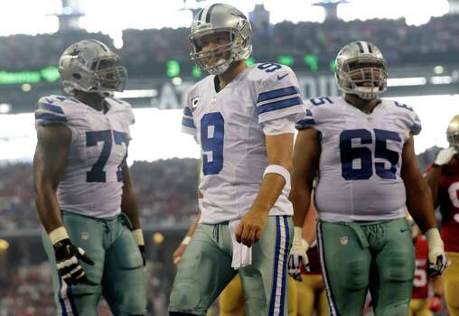 Dallas Cowboys quarterback Tony Romo (9), Tyron Smith (77) and Ronald Leary (65) on the field in the first half of an NFL football game against the San Francisco 49ers, Sunday, Sept. 7, 2014, in Arlington, Texas. (AP Photo/LM Otero) Photo: LM Otero, Associated Press / AP