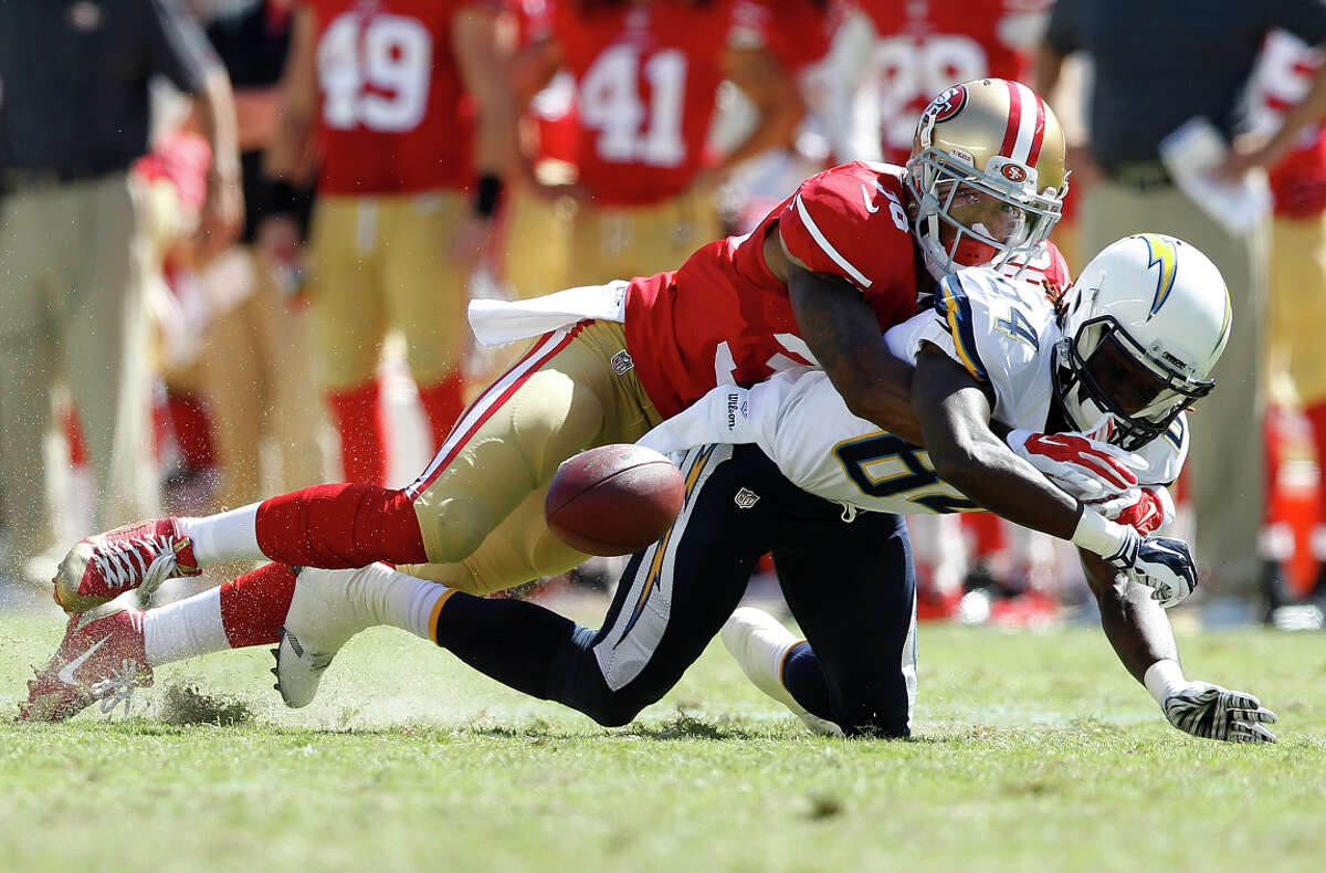 Fourth-round draft pick and 49ers cornerback Dontae Johnson hits then-Chargers wide receiver Tevin Reese in a preseason game in Santa Clara.