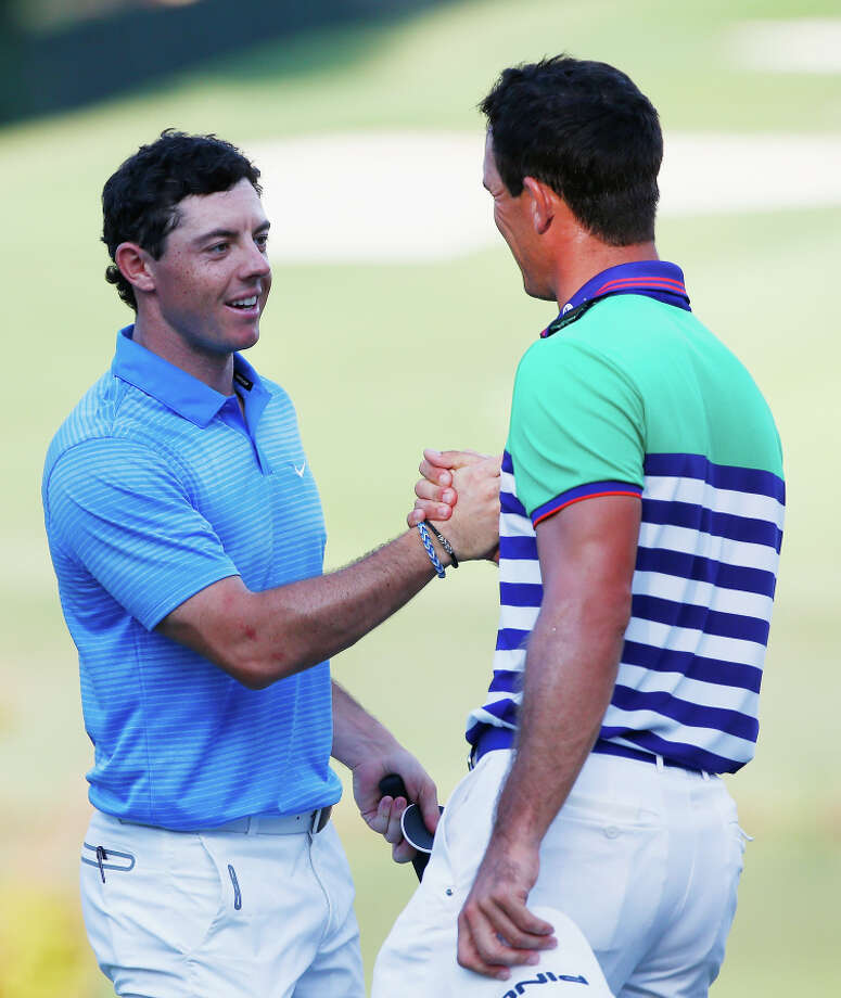 Rory McIlroy (left) caught Billy Horschel on the leaderboard and then for a post-round handshake. Photo: Sam Greenwood, Staff / Getty Images / 2014 Getty Images