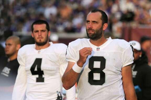 Raiders quarterback Matt Schaub (8) lost the starting job to Derek Carr (4), but the veteran remains a loyal teammate by tutoring the rookie.