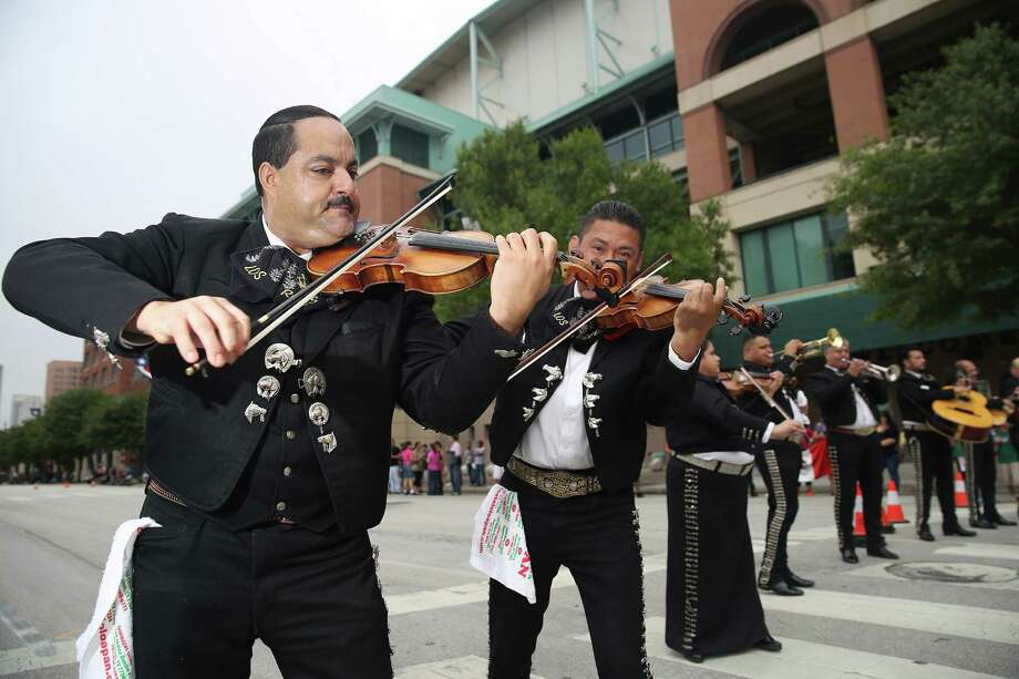 Gustabo Gomes plays the violin in the Mariachi Reyes de Mexico before the start of  the 46th Annual Fiesta Patrias International Parade in downtown Houston, TX. Photo: Thomas B. Shea, For The Chronicle / © 2014 Thomas B. Shea