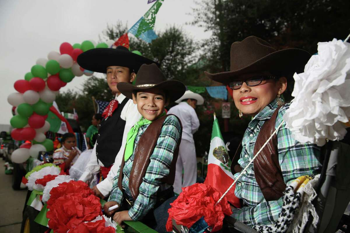 2. Harris County's Hispanics are young The median age of Latino residents here is 27, compared to 42 for the white population. More than half of all Harris County residents under the age of 20 are Hispanic.  From left to right, Jesse Mendez, age 12, Alejandro Nunez , age 8, and Maite Mendez, age 9, sit in a float before the start of the 46th Annual Fiesta Patrias International Parade in downtown Houston. Source: Shared Prospects: Hispanics and the Future of Houston