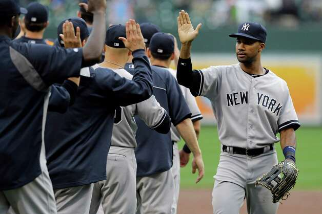 New York Yankees' Chris Young, right, high-fives teammates as he walks off the field after a baseball game against the Baltimore Orioles, Saturday, Sept. 13, 2014, in Baltimore. New York won 3-2. (AP Photo/Patrick Semansky) ORG XMIT: MDPS114 Photo: Patrick Semansky / AP