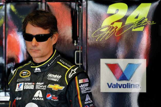 FILE - In this Aug. 1, 2014, file photo, driver Jeff Gordon wits in the garage during practice for the NASCAR Sprint Cup Series auto race at Pocono Raceway in Long Pond, Pa. Once unstoppable on the race track, Gordon has now gone 13 years without a championship. Now, at 43 years old, he feels he's got one of the best championship shots of his career. And, he wants nothing more than title No. 5.  (AP Photo/Matt Slocum, File) ORG XMIT: NY180 Photo: Matt Slocum / AP