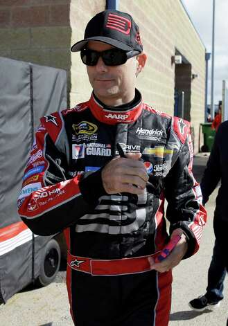 Driver Jeff Gordon walks to his garage during a practice for the NASCAR Sprint Cup Series auto race at Chicagoland Speedway in Joliet, Ill., Saturday, Sept. 13, 2014. (AP Photo/Nam Y. Huh)  ORG XMIT: ILNH106 Photo: Nam Y. Huh / AP