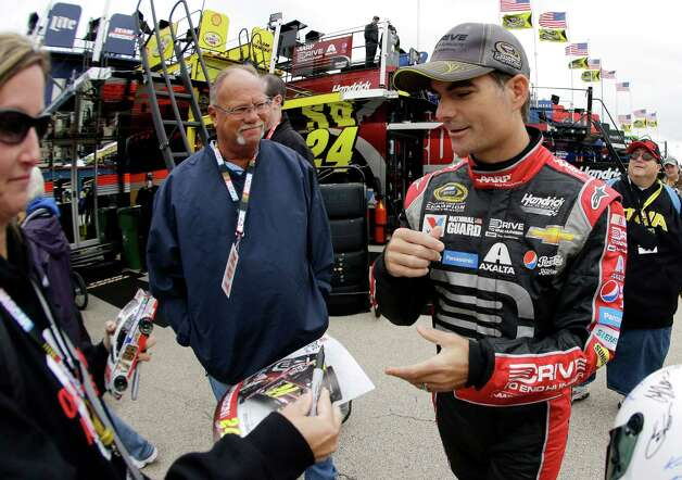 Driver Jeff Gordon signs autographs for fans during practice for the NASCAR Sprint Cup Series auto race at Chicagoland Speedway in Joliet, Ill., Friday, Sept. 12, 2014. (AP Photo/Nam Y. Huh)  ORG XMIT: ILNH108 Photo: Nam Y. Huh / AP
