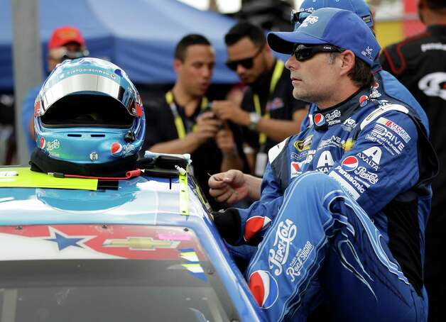 FILE - In this July 6, 2014, file photo, drver Jeff Gordon climbs into his car before the start of a NASCAR Sprint Cup series auto race at Daytona International Speedway in Daytona Beach, Fla. Once unstoppable on the race track, Gordon has now gone 13 years without a championship. Now, at 43 years old, he feels he's got one of the best championship shots of his career. And, he wants nothing more than title No. 5. (AP Photo/John Raoux, File) ORG XMIT: NY181 Photo: John Raoux / AP