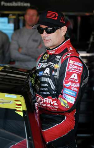 JOLIET, IL - SEPTEMBER 13:  Jeff Gordon, driver of the #24 Drive To End Hunger Chevrolet, climbs into his car during practice for the NASCAR Sprint Cup Series MyAFibStory.com 400 at Chicagoland Speedway on September 13, 2014 in Joliet, Illinois.  (Photo by Jonathan Daniel/Getty Images) ORG XMIT: 512369017 Photo: Jonathan Daniel / 2014 Getty Images