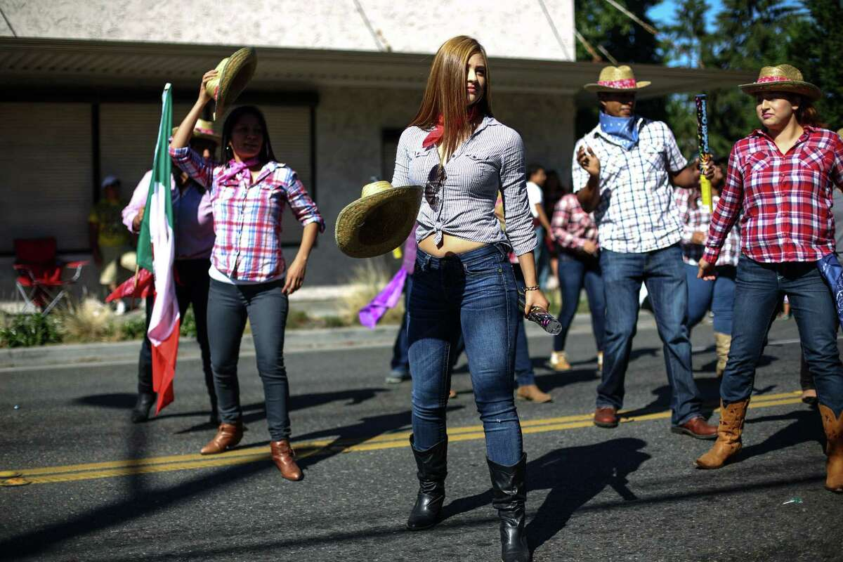 Byanka Mercado and members of Seattle Medical perform a dance during the annual Fiestas Patrias Parade in Seattle's South Park neighborhood.