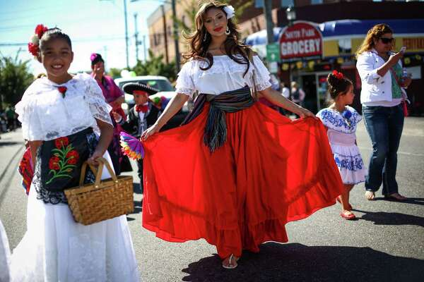 Elsa Aguilar of the Sea Mar Care Center holds her traditional dancing skirt during the annual Fiestas Patrias Parade in Seattle's South Park neighborhood. Fiestas Patrias celebrates the independence of Belize, Brazil, Chile, Costa Rica, El Salvador, Guatemala, Honduras, Mexico and Nicaragua. Photographed on Saturday, September 13, 2014.