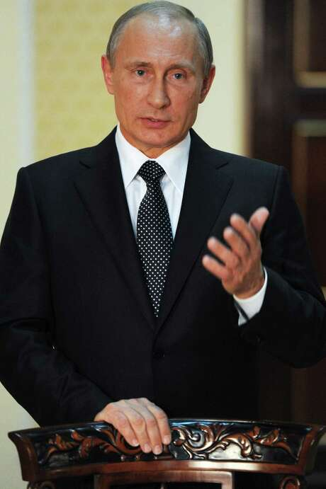 Russian President Vladimir Putin's portrait was taken Friday in Tajikistan. Photo: Presidential Press Service / RIA Novosti Kremlin