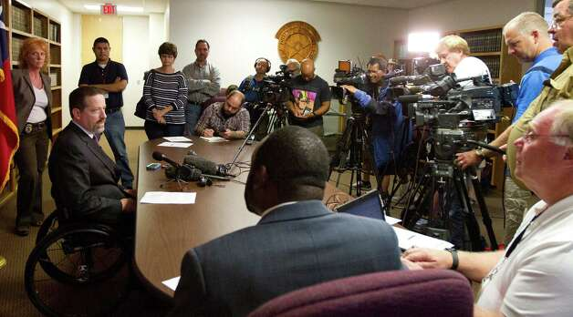 Montgomery County First Assistant District Attorney Phil Grant, left, answers questions from the media about the indictment of Minnesota Vikings running back Adrian Peterson, who is charged with injury to a child, Saturday, Sept. 13, 2014, in Conroe, Texas. Peterson turned himself in early Saturday at the jail in Montgomery County, and was released on bond. (AP Photo/ The Courier, Jason Fochtman) ORG XMIT: TXCON101 Photo: Jason Fochtman / Conroe Courier