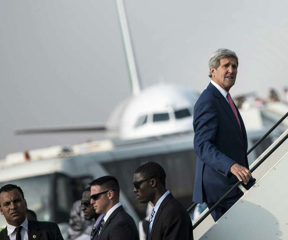 Secretary of State John Kerry boards his plane at Cairo International Airport as he leaves the Egyptian capital. He was there seeking to build support against ISIS. Photo: Brendan Smialowski / Associated Press / POOL AFP