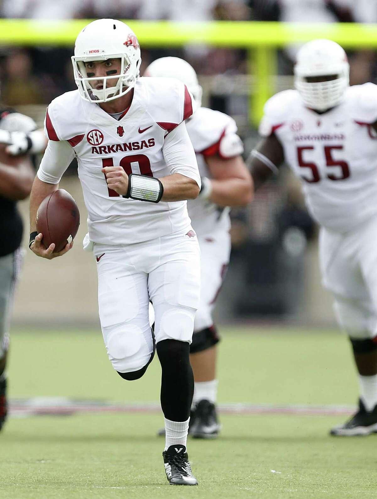 Arkansas' Brandon Allen (10) runs the ball against Texas Tech during an NCAA college football game in Lubbock, Texas, Saturday, Sept. 13, 2014.