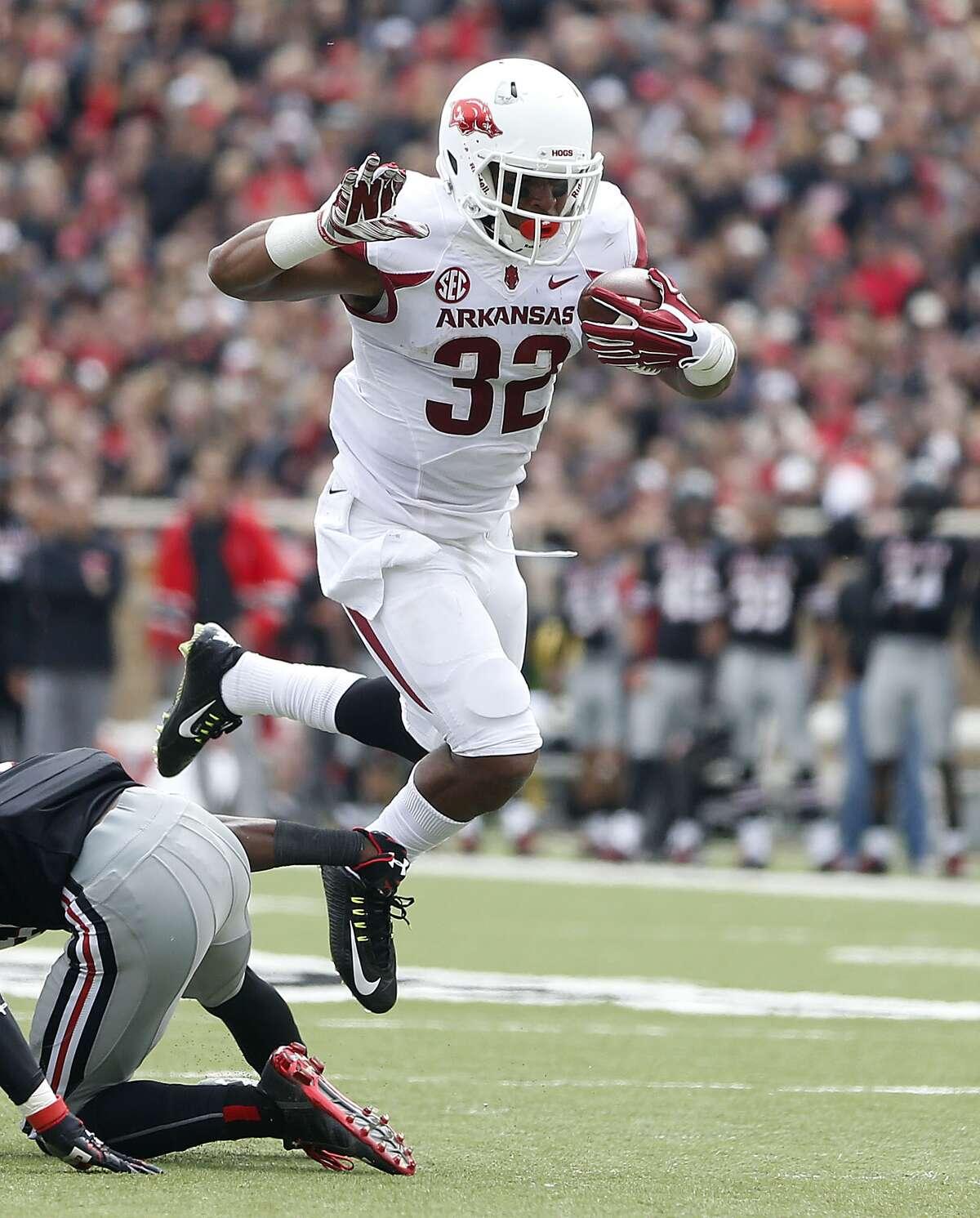 Arkansas' Jonathan Williams scores a touchdown against Texas Tech during an NCAA college football game in Lubbock, Texas, Saturday, Sept. 13, 2014.