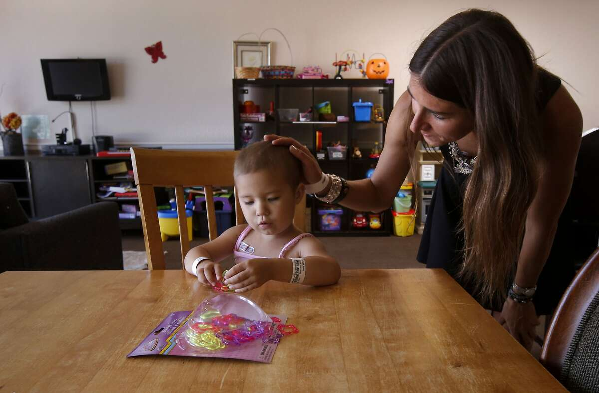 Brooks Bigart and her 3-year-old daughter Ronin make toy jewelry in the community room at the Koret Family House where Ronin has been staying with her family since Jan. 2014 while receiving treatment for Leukemia in San Francisco, Calif., as seen on Tuesday Sept. 9, 2014. Koret Family House provides. temporary housing to families of seriously ill children receiving treatment at the University of California San Francisco Benioff Children's Hospital.