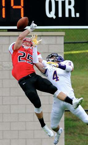 RPI's Ryan Buss, left, breaks up a pass intended for Alfred's Brendan Buisch during their football game on Saturday, Sept. 13, 2014, Rensselaer Polytechnic Institute in Troy, N.Y. (Cindy Schultz / Times Union) Photo: Cindy Schultz / 00028529A