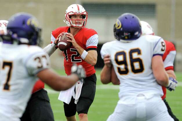 RPI's quarterback Jeff Avery, center, gets protection as he looks to pass during their football game against Alfred on Saturday, Sept. 13, 2014, Rensselaer Polytechnic Institute in Troy, N.Y. (Cindy Schultz / Times Union) Photo: Cindy Schultz / 00028529A