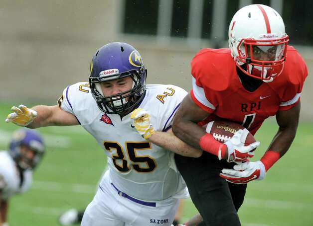 RPI's Reggie Colas, right, carries the ball as Alfred's Justin Liberta defends during their football game on Saturday, Sept. 13, 2014, Rensselaer Polytechnic Institute in Troy, N.Y. (Cindy Schultz / Times Union) Photo: Cindy Schultz / 00028529A