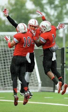 RPI's Logan Gaddar, center, celebrates a touchdown with Pat Hogan, left, and Reggie Colas during their football game against Alfred on Saturday, Sept. 13, 2014, Rensselaer Polytechnic Institute in Troy, N.Y. (Cindy Schultz / Times Union) Photo: Cindy Schultz / 00028529A