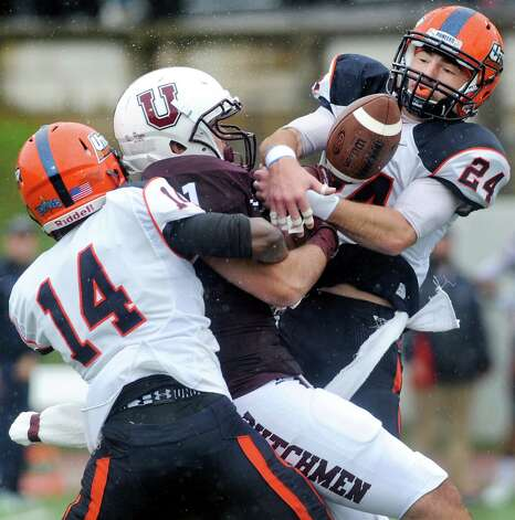 Union's Kyle Reynolds, center, can't hold onto a pass when double teamed by Utica's Irvens Eristil, left, and James Lenahan during their football game on Saturday, Sept. 13, 2014, at Union College in Schenectady, N.Y. (Cindy Schultz / Times Union) Photo: Cindy Schultz / 00028530A