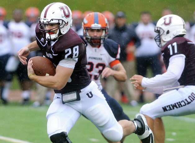 Union's Dylan Schuck, left, carries the ball during their football game against Utica on Saturday, Sept. 13, 2014, at Union College in Schenectady, N.Y. (Cindy Schultz / Times Union) Photo: Cindy Schultz / 00028530A
