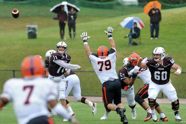 Union's quarterback Connor Eck, second from left, throws a pass during their football game against Utica on Saturday, Sept. 13, 2014, at Union College in Schenectady, N.Y. (Cindy Schultz / Times Union) Photo: Cindy Schultz / 00028530A