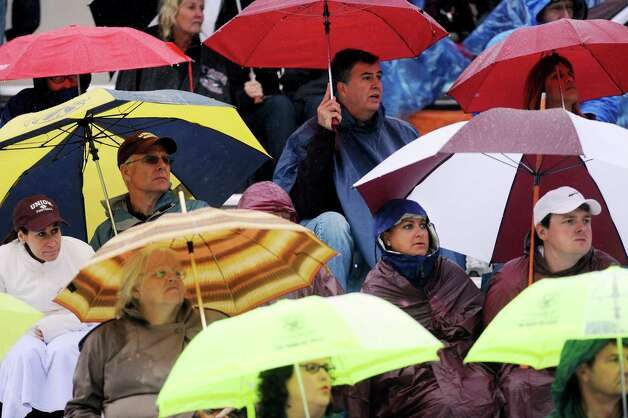 Union fans take cover from the rain during their football game on Saturday, Sept. 13, 2014, at Union College in Schenectady, N.Y. (Cindy Schultz / Times Union) Photo: Cindy Schultz / 00028530A