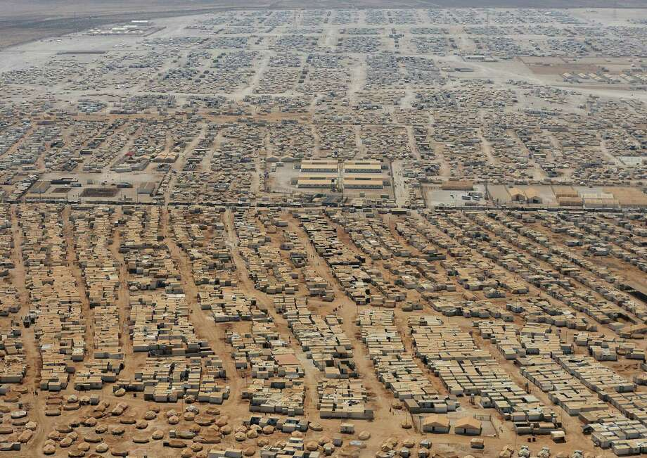"The Zaatari refugee camp reflects the vast numbers of people, some of whom are very young Syrian brides. ""The parents feel a man can protect"" their daughters, says a Jordan official. Photo: Mandel Ngan / Associated Press / AFP Pool"