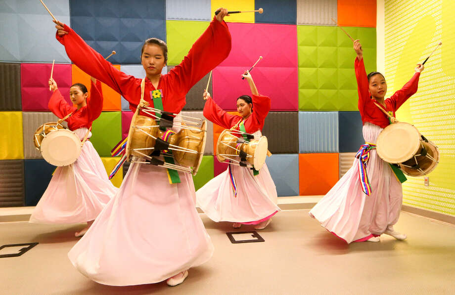 The youth dance group from the Korean American Cultural Center of San Antonio performs the Jango, a drum dance, at the BiblioTech main branch on Saturday. A variety of activities marked BiblioTech's first anniversary. / Express-News 2014
