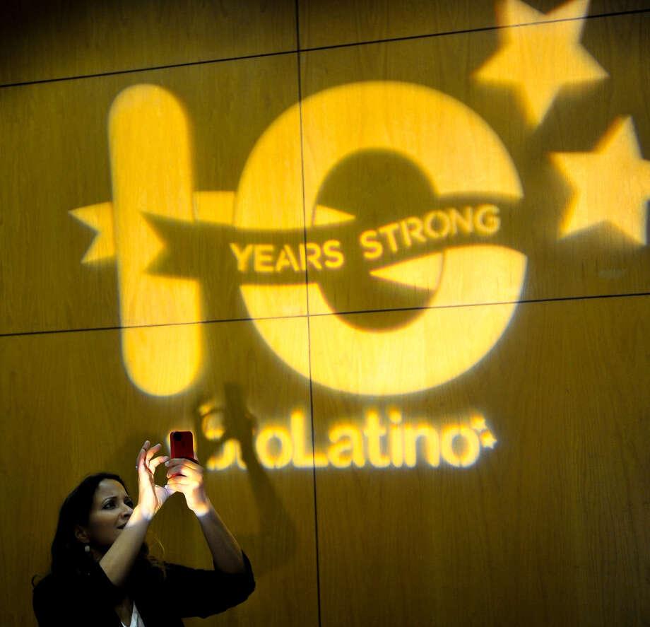 Michelle Minguez, Voto Latino's vice president of development, takes photos at the group's Power Summit. Photo: Robin Jerstad / For The San Antonio Express-News