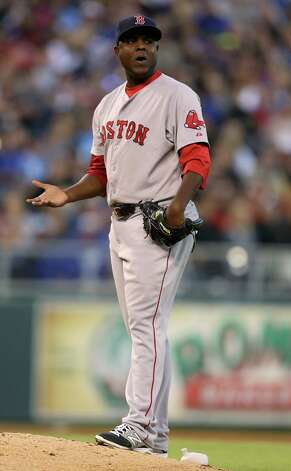 KANSAS CITY, MO - SEPTEMBER 13:  Starting pitcher Rubby De La Rosa #62 of the Boston Red Sox reacts after he was charged with a balk that scored Salvador Perez of the Kansas City Royals   in the fourth inning at Kauffman Stadium on September 13, 2014 in Kansas City, Missouri. (Photo by Ed Zurga/Getty Images) ORG XMIT: 477589863 Photo: Ed Zurga / 2014 Getty Images