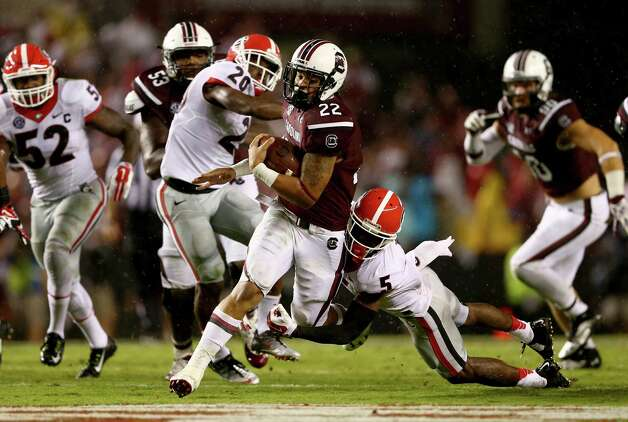 COLUMBIA, SC - SEPTEMBER 13:  Damian Swann #5 of the Georgia Bulldogs tries to stop Brandon Wilds #22 of the South Carolina Gamecocks as he runs with the ball during their game at Williams-Brice Stadium on September 13, 2014 in Columbia, South Carolina.  (Photo by Streeter Lecka/Getty Images) ORG XMIT: 508040695 Photo: Streeter Lecka / 2014 Getty Images